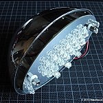 LED board mounted in lamp shell