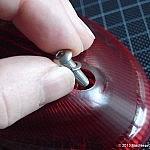 Inserting the new lens screws