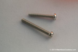 The indicator lens screws